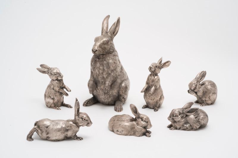 Набор из кувшина в виде фигурок зайца и шести зайчат. 1894